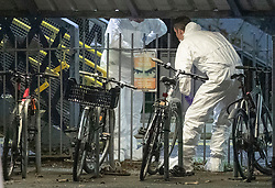 © Licensed to London News Pictures. 04/01/2019. Horsley, UK. Forensics officers are seen amongst bicycles at Horsley Railway station in Surrey where a man has been stabbed to death on a train. A murder investigation has been launched after the man was attacked while on board the 12. 58pm train service travelling between Guildford and London Waterloo. . Photo credit: Peter Macdiarmid/LNP