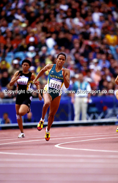 Cathy Freeman of Australia in action during the Women's 200m heat at the Sydney Olympic Games, on September 27 2000. Photo: PHOTOSPORT<br />