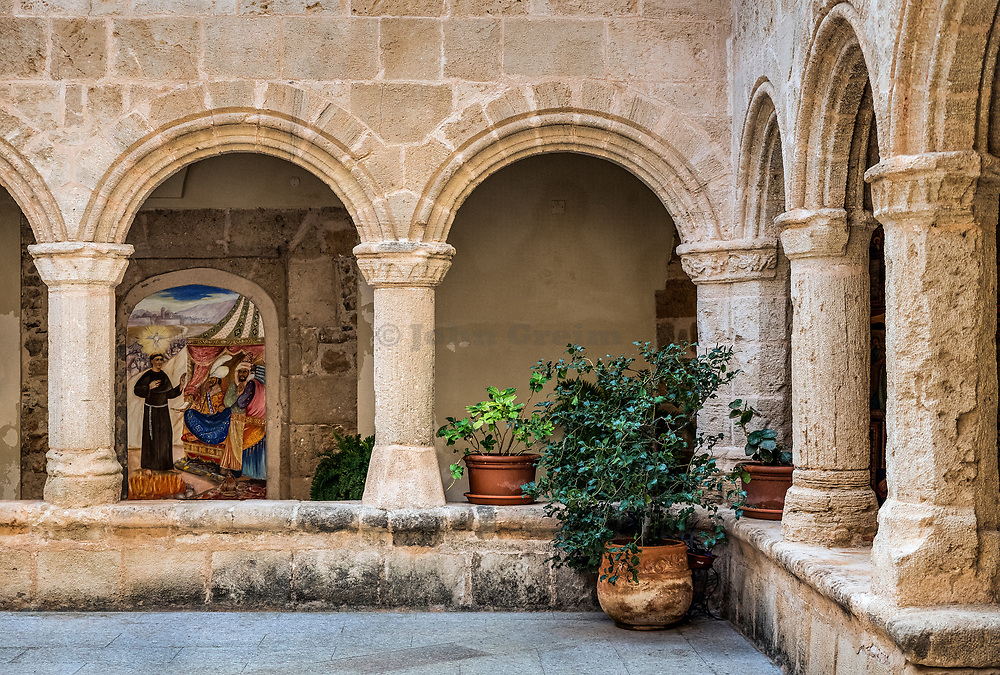 Cloisters courtyard, San Francesco Church in old town, Alghero, Sardinia, italy.