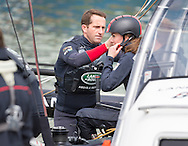Sir Ben Ainslie adjusts the Duchess of Cambridge's helmet while aboard an America's Cup catamaran during a visit to Land Rover BAR base in Portsmouth, Hampshire. <br /> Picture date Friday 20th May, 2016.<br /> Picture by Christopher Ison. Contact +447544 044177 chris@christopherison.com