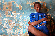 Teenager without judgment residing with condemned, Cotonou, Benin september 2003 - The prison of Cotonou has a part reserved for the young criminals. Many of these young criminals are street children who consume drugs.  They have been put in prison for the use, possession and/or trade of drug; and also often for violence and rape. Visiting room.