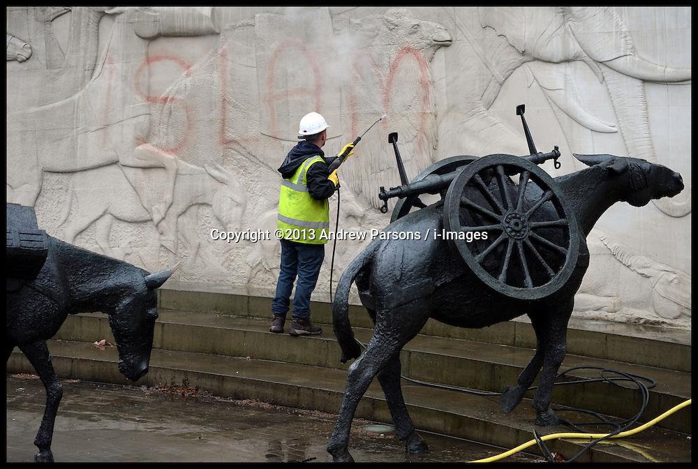 The Clean-up operation begins at war memorials defaced with Islamic slogans in London. The word 'Islam' is removed from the Animals In War memorial in Park Lane, London,.Tuesday, 28th May 2013.Picture by Andrew Parsons / i-Images