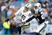 NASHVILLE, TN - NOVEMBER 29:  Michael Crabtree #15 of the Oakland Raiders has a pass knocked away by Coty Sensabaugh #24 of the Tennessee Titans at Nissan Stadium on November 29, 2015 in Nashville, Tennessee.  (Photo by Wesley Hitt/Getty Images) *** Local Caption *** Michael Crabtree; Coty Sensabaugh