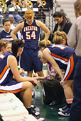 10 January 2009: Coach Beth Baker draws a play for her team in a time out huddle.  Kelly Brooks (54) looks on. The Lady Titans of Illinois Wesleyan University downed the and Lady Thunder of Wheaton College by a score of 101 - 57 in the Shirk Center on the Illinois Wesleyan Campus in Bloomington Illinois.