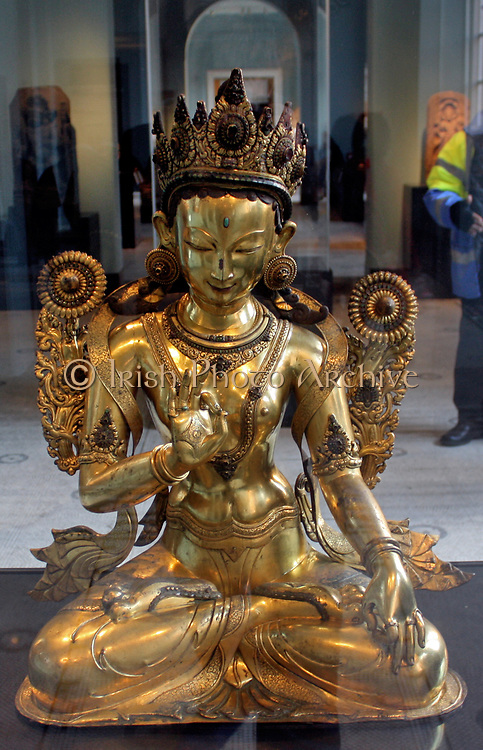 White Tara (1500-1600) Nepal, Gilded copper.  White Tara is one of the most revered, enlightened goddesses in Tibet.  She is shown here with her usual symbols, two open lotus flowers on stalks, one behind each shoulder.