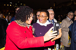 "London, October 23 2017. Nelson Mandela's group of Elders including former UN Secretary General Kofi Annan and Secretary General Ban Ki-moon accompanied by his widow Graca Machel gather at Parliament Square at the start of the Walk Together event in memory of Nelson Mandela before a candlelight vigil at his statue in Parliament Square. ""WalkTogether is a global campaign to inspire hope and compassion, celebrating communities working for the freedoms that unite us"". PICTURED: A woman asks for a selfie with Graca Machel. © Paul Davey"