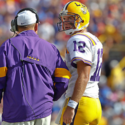 October 8, 2011; Baton Rouge, LA, USA; LSU Tigers head coach Les Miles talks with quarterback Jarrett Lee (12) during the first quarter against the Florida Gators at Tiger Stadium.  Mandatory Credit: Derick E. Hingle-US PRESSWIRE / © Derick E. Hingle 2011