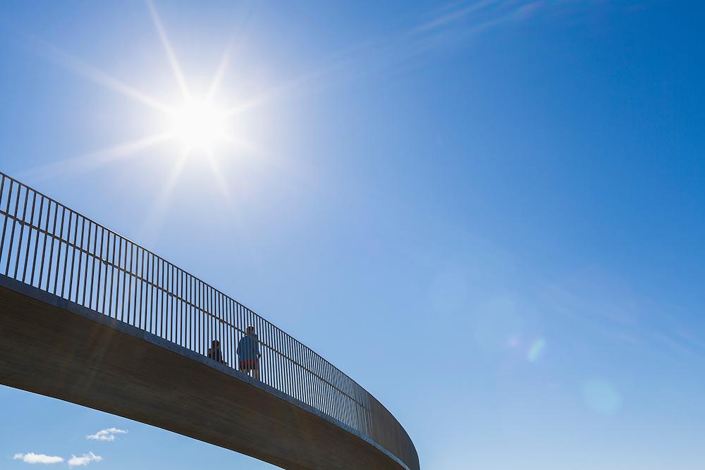 Joggers on a bridge