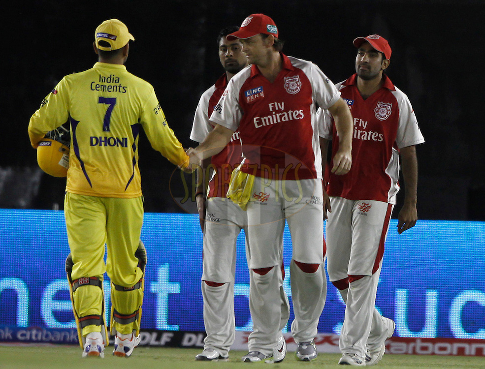 Kings XI Punjab captain Adam Gilchrist  hand shaks with Chennai Super King captain MS Dhoni after winning the match 9 of the Indian Premier League ( IPL ) Season 4 between the Kings XI Punjab and the Chennai Super Kings held at the PCA stadium in Mohali, Chandigarh, India on the 13th April 2011..Photo by Pankaj Nangia/BCCI/SPORTZPICS