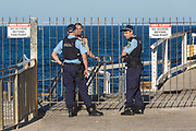 Sydney, Australia. Saturday 25th April 2020. Bronte Beach in Sydney's eastern suburbs is closed due to the COVIC-19 pandemic. Police moving on a swimmer which is not allowed. Credit Paul Lovelace/Alamy Live News