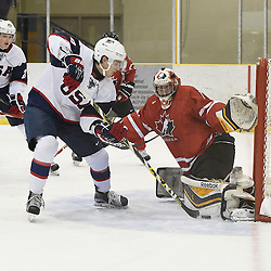 WELLINGTON, - Dec 11, 2015 -  Exhibition Game 2- Team USA vs Team Canada East at the 2015 World Junior A Challenge at the Wellington District Community Centre, ON. Colton Point #1 of Team Canada East battles for control with Max Zimmer #6 of Team United States during the first period.<br /> (Photo: Andy Corneau / OJHL Images)