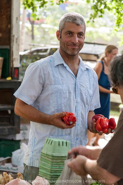 Farmer Rodrigo Venturelli of Plan B Organic Farm at Dufferin Grove farmers market.