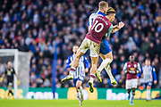 Jack Grealish (Capt) (Aston Villa) & Adam Webster (Brighton) after attempting to head the ball during the Premier League match between Brighton and Hove Albion and Aston Villa at the American Express Community Stadium, Brighton and Hove, England on 18 January 2020.