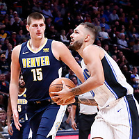 11 November 2017: Orlando Magic forward Evan Fournier (10) drives past Denver Nuggets center Nikola Jokic (15) during the Denver Nuggets 125-107 victory over the Orlando Magic, at the Pepsi Center, Denver, Colorado, USA.