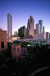 Dusk view of the Houston, Texas skyline with Bayou Place and the Wortham Center Waterfall in the foreground.