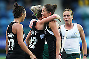 Krystal Forgesson of New Zealand celebrates her goal with teammates Anita Punt and Jordan Grant during the bronze medal match between New Zealand and South Africa. Glasgow 2014 Commonwealth Games. Hockey, Bronze Medal Match, Black Sticks Women v South Africa, Glasgow Green Hockey Centre, Glasgow, Scotland. Saturday 2 August 2014. Photo: Anthony Au-Yeung / photosport.co.nz