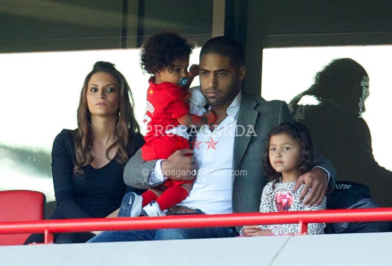 LIVERPOOL, ENGLAND - Saturday, September 21, 2013: Injured Liverpool player Glen Johnson watches the game between Liverpool and Southampton during the Premiership match at Anfield. (Pic by David Rawcliffe/Propaganda)