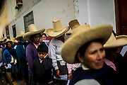 Indigenous women from around Namorcocha  high mountain lagoon wait in line to subscribe to a welfare program to lower classes, JUNTOS, in Cajamarca, Peru, Wednesday, October 21, 2015.(Hilaea Media/ Dado Galdieri)