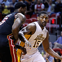 10 March 2011: Los Angeles Lakers small forward Ron Artest (15) drives past Miami Heat small forward LeBron James (6) during the Miami Heat 94-88 victory over the Los Angeles Lakers at the AmericanAirlines Arena, Miami, Florida, USA.