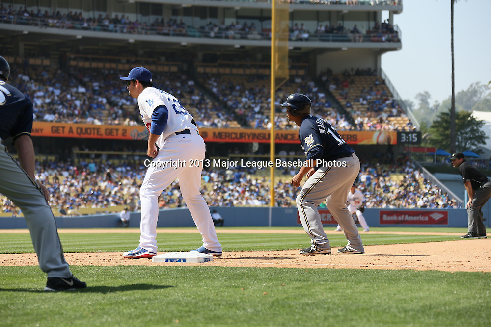 LOS ANGELES, CA - APRIL 28:  Adrian Gonzalez #23 of the Los Angeles Dodgers covers first base as Ryan Braun #8 of the Milwaukee Brewers leads off during the game against the Milwaukee Brewers on Sunday, April 28, 2013 at Dodger Stadium in Los Angeles, California. The Dodgers won the game 2-0. (Photo by Paul Spinelli/MLB Photos via Getty Images) *** Local Caption *** Adrian Gonzalez;Ryan Braun