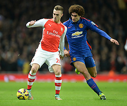 Manchester United's Marouane Fellaini puts pressure on Arsenal's Calum Chambers - Photo mandatory by-line: Alex James/JMP - Mobile: 07966 386802 - 22/11/2014 - Sport - Football - London - Emirates Stadium - Arsenal v Manchester United - Barclays Premier League