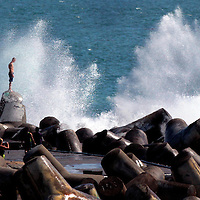 A man takes his life into his hands, and feet, as he stands his ground and stares into an incoming wave at the Santa Cruz Harbor Jetty in Santa Cruz, California on SundaySeptember 30. The recent swell continued to produce some large waves and a few of local locations along the coast. Throughout the years a number of people have lost their lives, being swept out to sea by strong and often unpredictable waves.<br />Photo by Shmuel Thaler/Santa Cruz Sentinel
