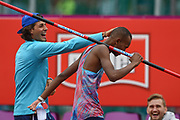Mutaz Essa Barshim of Qatar during the Men's High Jump celebrates  with fellow competitors a World Lead and Meeting Record of 2.4m  by taking the pole during the Muller Grand Prix Birmingham 2017 at the Alexander Stadium, Birmingham, United Kingdom on 20 August 2017. Photo by Martin Cole.