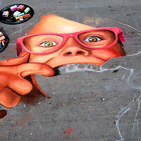 Little Girl Spreads Lips to Show Teeth at Chalk Art Festival in Denver, Colorado<br />