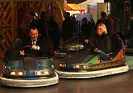 david furnish and girls alound singer at a fair ground in london 15.12.06.pix