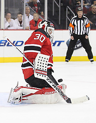 Oct 13; Newark, NJ, USA; New Jersey Devils goalie Martin Brodeur (30) makes a save during the first period of their game against the Los Angeles Kings at the Prudential Center.