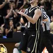 Central Florida guard A.J. Rompza (3) yells after winning  the NCAA basketball game against the USF Bulls at the UCF Arena on November 18, 2010 in Orlando, Florida. UCF won the game 65-59. (AP Photo/Alex Menendez)