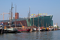 Nemo, officially known as the Science Center Nemo Museum, is impossible to miss in Amsterdam's busy harbor.  Designed by Renzo Piano to mimic the hull of a huge vessel and opened in 1997, it contains five floors of interactive exhibits for all ages.