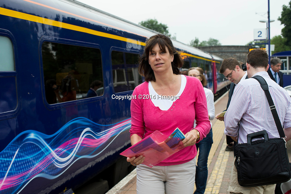 Image ©Licensed to i-Images Picture Agency. 23/07/2014. Marlborough, United Kingdom. Transport Minister Claire Perry meets commuters at Bedwyn station. Wiltshire.Picture by i-Images