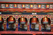 Colourful prayer wheels at the Kyichu Buddhist Temple in Paro, Bhutan.