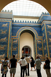 Visitors looking at Ishtar Gate from Babylon at Pergamon Museum in Berlin Germany