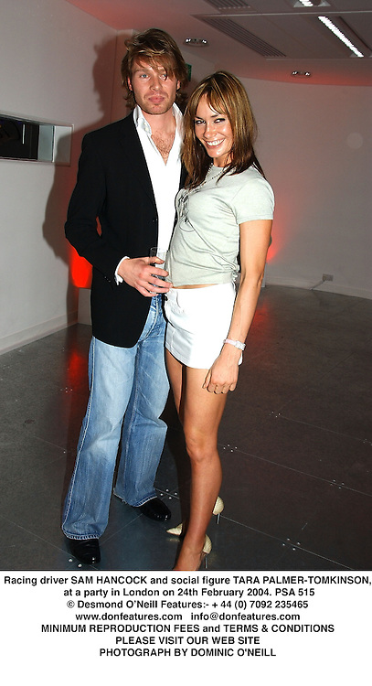 Racing driver SAM HANCOCK and social figure TARA PALMER-TOMKINSON, at a party in London on 24th February 2004.PSA 515