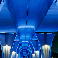 Under the bridge to the Port of Miami at night with blue lights