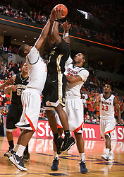 Virginia forward Jamil Tucker (12) blocks a shot by Wake Forest guard L.D. Williams (42).  The Virginia Cavaliers fell to the #13 ranked Wake Forest Demon Deacons 70-60 at the John Paul Jones Arena on the Grounds of the University of Virginia in Charlottesville, VA on February 28, 2009.