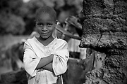 Seven year old Malian boy Moise Dako poses for a photograph in the street in which he lives in Diabaly, Mali 26 January 2013. This photograph is part of a picture package of portraits showing children living along the same street in the small rice growing community of the northern Malian town of Diabaly who in the month of January 2013 lived through a rapid chain of events in the Malian war.