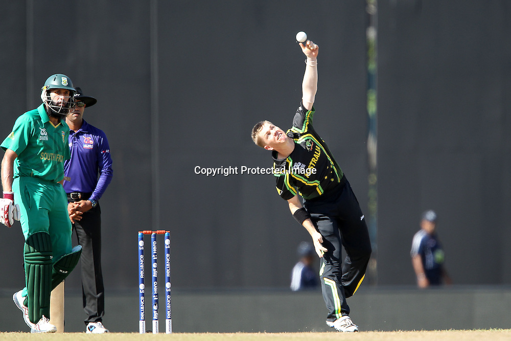 Xavier Doherty bowls during the ICC World Twenty20 Super 8s match between Australia and South Africa held at the Premadasa Stadium in Colombo, Sri Lanka on the 30th September 2012<br /> <br /> Photo by Ron Gaunt/SPORTZPICS