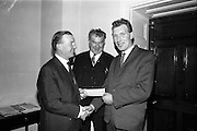 19/04/1966<br /> 04/19/1966<br /> 19 April 1966 <br /> Cheque presentation at the Department of Agriculture for the National Dairy Publicity Council. Mr. Charles Haughey T.D., Minister for Agriculture presents a cheque to Mr. Joseph ?, A worker with TEK (Tel El Kebir) Dairy.