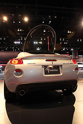 11 February 2009: 2009 Pontiac Solstice Sports Coupe - Reborn: 2009 PONTIAC SOLTICE COUPE: Drawing on the success of the convertible model, which is today?s top-selling roadster in the U.S., is the?09 Pontiac Solstice coupe. The coupe?s roof is fixed aft of the B-pillars, with side windows and a rear liftglass for access to the cargo area. One person can remove the removable roof panel over the passenger compartment and the roof has a ?carved out? inner contour that greatly enhances headroom, for a maximum of 37.4 inches. A home storage case for the roof panel is offered through GM Accessories. Two engines are available, with a standard 173 horsepower, 2.4-liter Ecotec 4-cylinder, and the GXP version is equipped with a 2.0L turbocharged Ecotec with 260 horsepower.. The Chicago Auto Show is a charity event of the Chicago Automobile Trade Association (CATA) and is held annually at McCormick Place in Chicago Illinois.