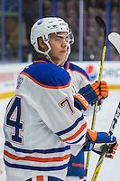 PENTICTON, CANADA - SEPTEMBER 16: Ethan Bear #74 of Edmonton Oilers stands at the bench during warm up against the Vancouver Canucks on September 16, 2016 at the South Okanagan Event Centre in Penticton, British Columbia, Canada.  (Photo by Marissa Baecker/Shoot the Breeze)  *** Local Caption *** Ethan Bear;