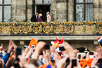 30th April 2013 Amsterdam, Netherlands. Dam Square. Queen Beatrix' abdication takes place, and her son Prince Willem-Alexander will be King of the Netherlands. King Willem Alexander kissing his mother, now princess Beatrix and queen maxima stands at the right looking at the thousands enthousiast Dutch from the balcony