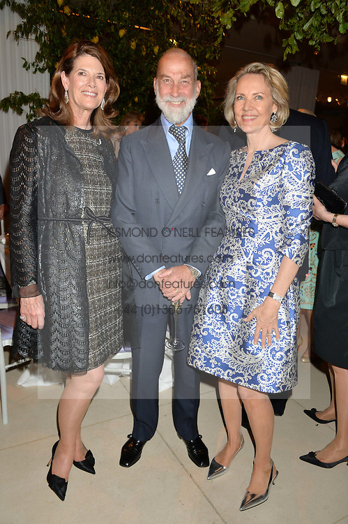 Left to right, FRANCESCA SCHWARZENBACH, HRH PRINCE MICHAEL OF KENT and CARLA BAMBERGER at a dinner hosted by Cartier in celebration of The Chelsea Flower Show held at The Hurlingham Club, London on 19th May 2014.
