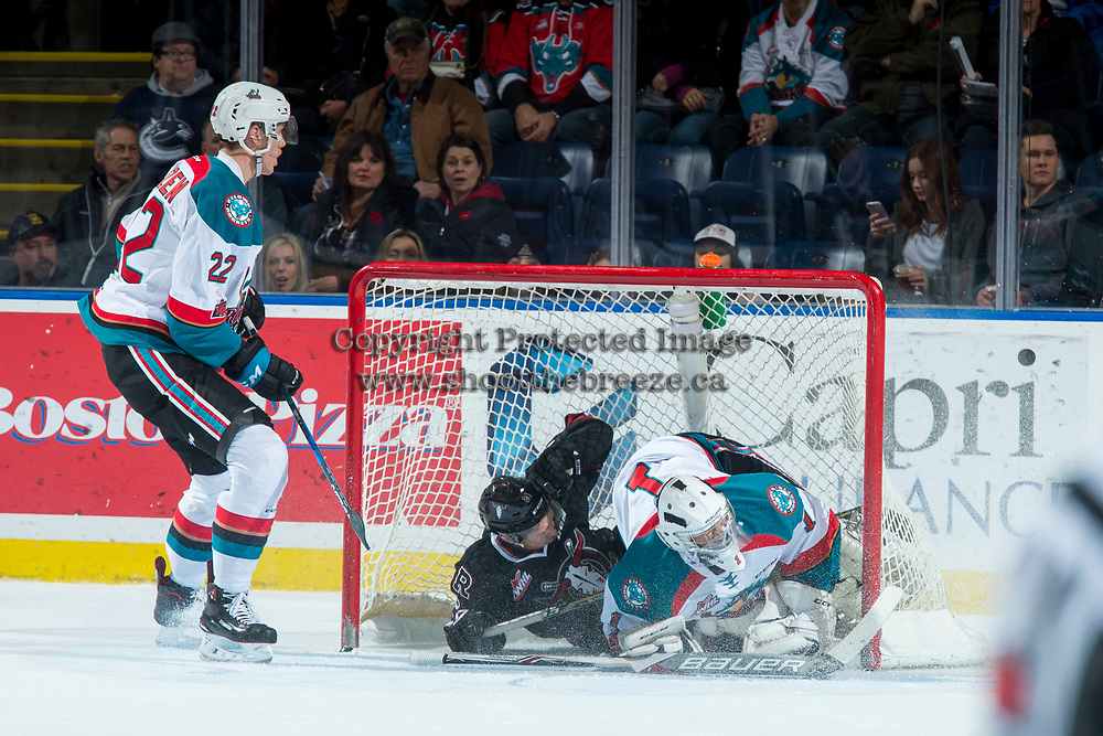 KELOWNA, CANADA - NOVEMBER 11: Mason McCarty #9 of the Red Deer Rebels slides into the net of James Porter #1 of the Kelowna Rockets during first period on November 11, 2017 at Prospera Place in Kelowna, British Columbia, Canada.  (Photo by Marissa Baecker/Shoot the Breeze)  *** Local Caption ***