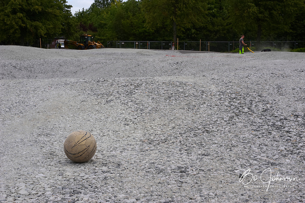 """The contractor Svensk Markservice AB is building the Worlds first """"Puckelball field"""" in the Kroksback Park in Malmo, Southern Sweden.<br /> The unusual soccer field 25 x 40 meter is designed by Swedish artist Johan Ferner Strom ( http://www.johanstrom.com ). The soccer field is regarded both as a interactive sculpture and an arena for playful competition.<br /> Drawings and construction details are carried out by the engineering company Ramboll ( http://www.ramboll.se ).<br /> The smooth rolling L-shaped concrete elements forming the rim around the field are manufactured by S:t Eriks ( http://www.steriks.se ), specialists in prefabricated concrete elements.<br /> The surface of the field will be artificial grass.<br /> The unusual soccer field will open to the public in September 2009.<br /> The Puckelball field is design protected.<br /> June 2009.<br /> Only for editorial use."""