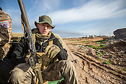 "KURDISTAN, NORTHERN IRAQ, Dokuk.<br /> Qalubna Ma'Kum Feature:<br /> Qalubna Ma'kum (meaning ""Our hearts are With You"") are a group of foreign volunteer fighters who have joined up with the Peshmerga in Kurdistan to help with the battle against Daesh, also known as ISIS. <br /> <br /> Pictured: US volunteer Joe Pollard on patrol on the southern front lines of Kirkuk, Kurdistan."