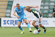 Chris Hussey and George Cooper  during the EFL Sky Bet League 2 match between Plymouth Argyle and Cheltenham Town at Home Park, Plymouth, England on 21 September 2019.