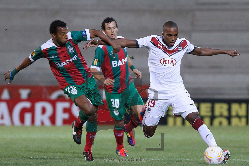 Portugal, Funchal, Madeira : Bordeaux's French forward Maurice Belay    vies with Maritimo's Brazilien defender João Luiz during the UEFA Europa league football match CS Maritimo vs FC Girondins de Bordeaux on October 25, 2012 at the Barreiros stadium in Funchal..Photo Gregório Cunha
